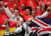 Fernando Alonso and Lewis Hamilton celebrate